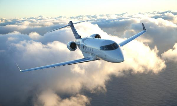 The Bombardier Challenger 300 is a super-mid-sized jet capable of traveling transcontinental distances. All of the passenger seats are fully adjustable and have fold-out tables and individual AC power plugs. Two-zone air conditioning keeps both the pilots and the passengers comfortable, and low-heat LED overhead lights (with a 10,000-hour life) give the cabin an open feel.