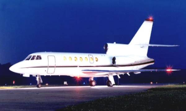 The Dassault Falcon 50 is a French-built long-range corporate jet, featuring a three jet engine layout with an S-duct central engine. The nine-passenger seating configuration is generally laid out in one four-seat club arrangement, and a separate section of two facing seats and a three-seat divan. Work tables fold out between facing seats so work can be completed in-flight. Power plugs are available for laptops and office equipment. Temperature control is separate for the cockpit and the cabin, so both part